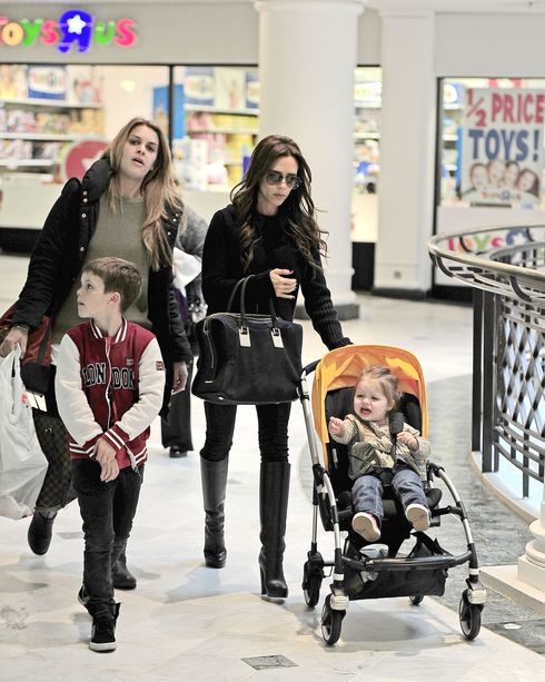 EXC - VICTORIA BECKHAM AND FAMILY AT TOYS R US!