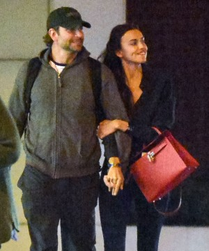 Exclusive... 51729723 First Look: Actor Bradley Cooper and model Irina Shayk confirm their relationship with a night packed full of PDA in New York City, New York on May 3, 2015. The pair went to a late showing of the play 'Hamilton' and made sure to hold hands, laugh, and even stop for a mini make-out session after the show. **NO INTERNET USE** FameFlynet, Inc - Beverly Hills, CA, USA - +1 (818) 307-4813