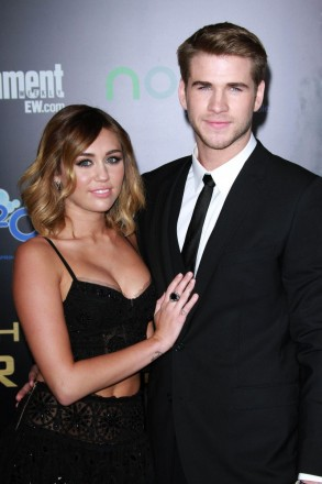 Mandatory Credit: Photo by Jim Smeal / BEImages (1012347bm) Liam Hemsworth and Miley Cyrus 'The Hunger Games' film premiere, Los Angeles, America - 12 Mar 2012