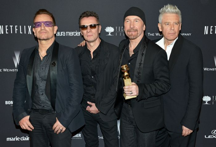 (L-R) U2's Bono, Larry Mullen Jr., The Edge and Adam Clayton arrive at the Weinstein Company and Netflix Golden Globes after party in Los Angeles, California on January 12, 2014.  UPI/Christine Chew / eyevine Contact eyevine for more information about using this image: T: +44 (0) 20 8709 8709 E: info@eyevine.com http://www.eyevine.com *** Local Caption *** 01223580