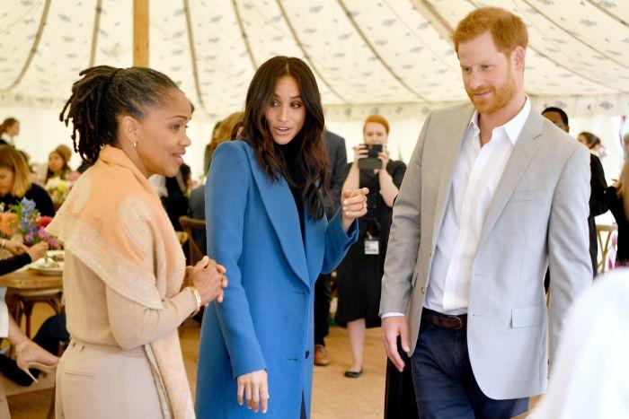 Doria Ragland, alături de fiica sa și de Prințul Harry