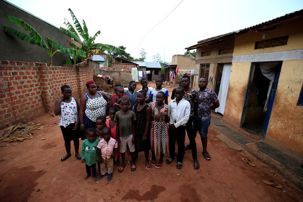0_Mariam-Nabatanzi-a-mother-of-38-takes-a-family-portrait-with-some-of-her-children-at-their-home-in