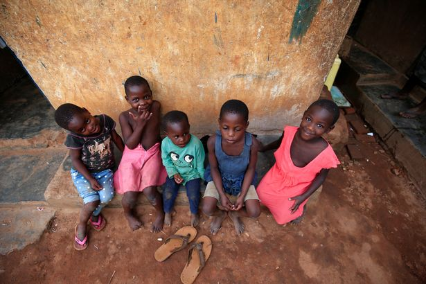 0_Mariam-Nabatanzis-children-rest-on-the-verandah-at-their-home-in-Kasawo-village