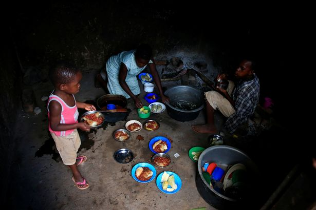 0_Mariam-Nabatanzis-children-serve-a-meal-at-their-family-home-in-Kasawo-village